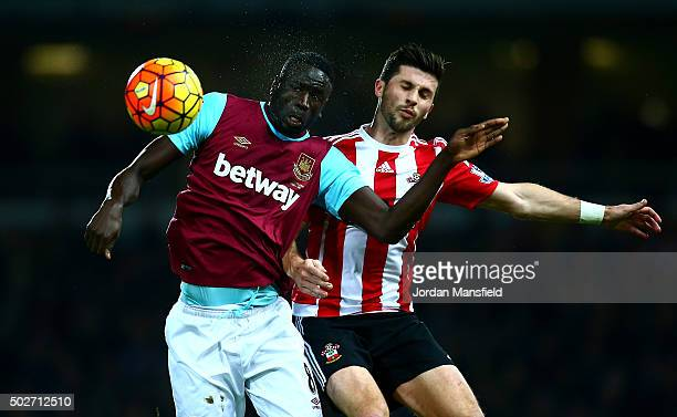 Cheikhou Kouyate of West Ham United battles for the ball with Jose Fonte of Southampton during the Barclays Premier League match between West Ham...
