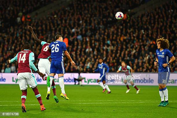 Cheikhou Kouyate of West Ham United beats John Terry of Chelsea in the air to score his sides first goal during the EFL Cup fourth round match...