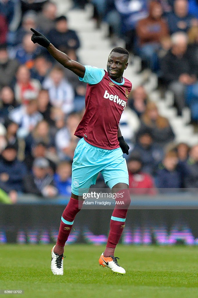 Cheikhou Kouyate of West Ham United celebrates scoring a goal to make the score 0-1 during the Barclays Premier League match between West Bromwich Albion and West Ham United at The Hawthorns on April 30, 2016 in West Bromwich, United Kingdom.