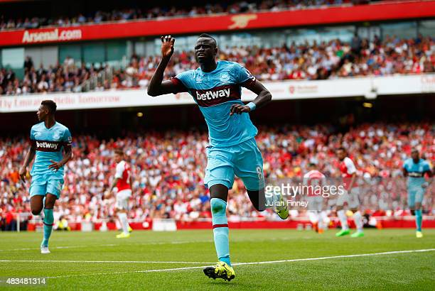 Cheikhou Kouyate of West Ham United celebrates scoring the opening goal during the Barclays Premier League match between Arsenal and West Ham United...