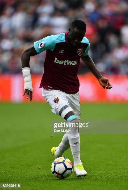 Cheikhou Kouyate of West Ham United controls the ball during the Premier League match between West Ham United and Swansea City at London Stadium on...