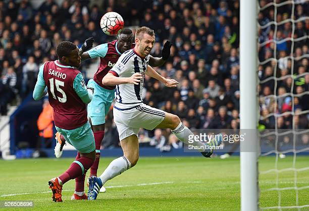 Cheikhou Kouyate of West Ham United heads the ball to score his team's first goal during the Barclays Premier League match between West Bromwich...