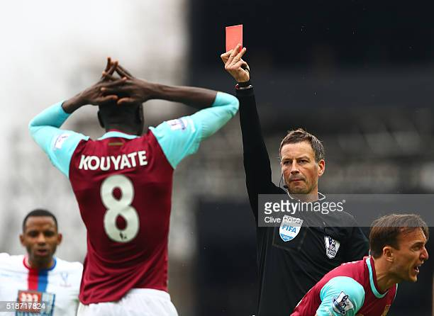 Cheikhou Kouyate of West Ham United is shown a red card by referee Mark Clattenburg during the Barclays Premier League match between West Ham United...