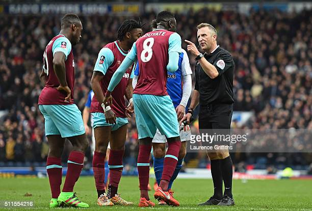 Cheikhou Kouyate of West Ham United is shown a straight red card by referee Jonathan Moss during The Emirates FA Cup fifth round match between...