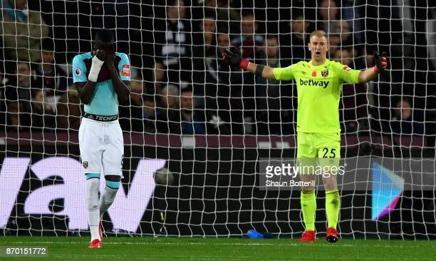 Cheikhou Kouyate of West Ham United looks dejected while Joe Hart of West Ham United reacts during the Premier League match between West Ham United...