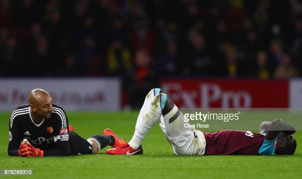 Cheikhou Kouyate of West Ham United reacts as he is foiled by Heurelho Gomes of Watford during the Premier League match between Watford and West Ham...