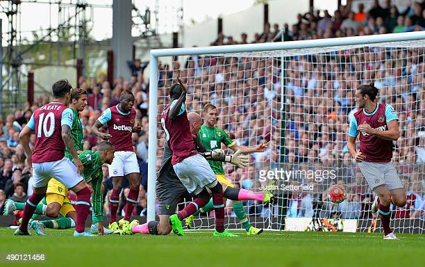 Cheikhou Kouyate of West Ham United scores his team's second goal during the Barclays Premier League match between West Ham United and Norwich City...