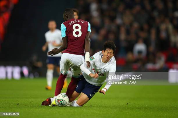 Cheikhou Kouyate of West Ham United tackles Son Heungmin of Tottenham Hotspur during the Carabao Cup Fourth Round match between Tottenham Hotspur and...