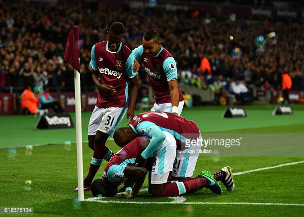 Cheikhou Kouyate of West Ham Unitwins a header celebrates scoring his sides first goal with his West Ham United team mates during the EFL Cup fourth...