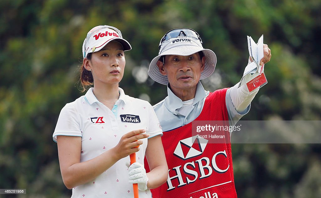 Chella Choi lines up her tee shot on the 16th hole with her father/caddie Ji Yeon during the first round of the HSBC Women's Champions at the Sentosa...