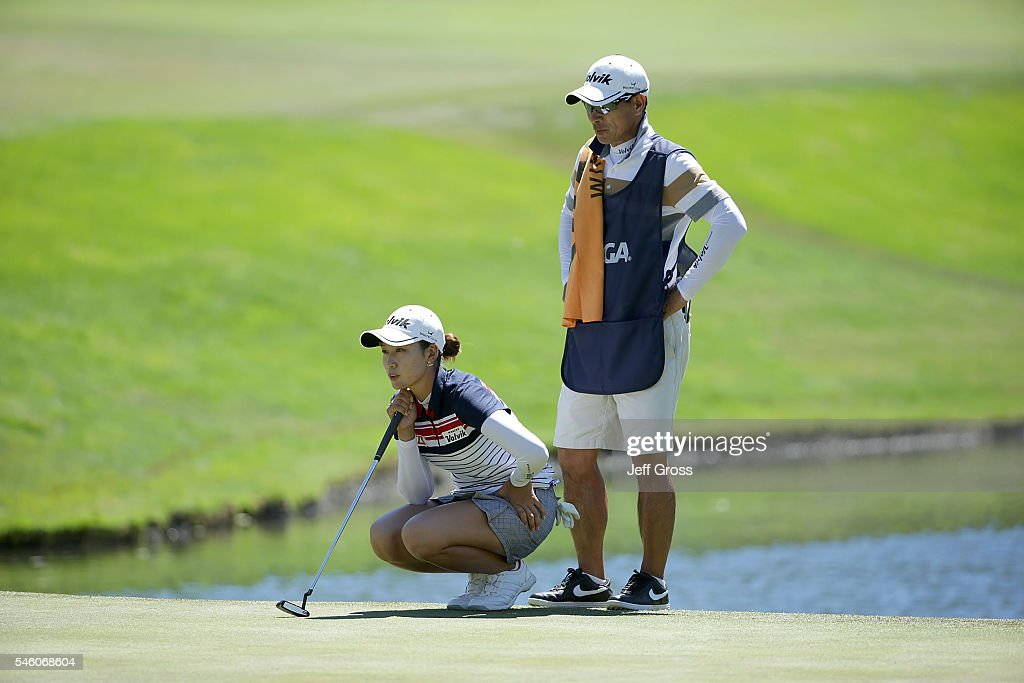 Chella Choi of South Korea, and her father and caddy Ji Yeom Choi, line up a putt on the 18th green during the final round of the U.S. Women's Open at the Cordevalle Golf Club on July 10, 2016 in San Martin, California.
