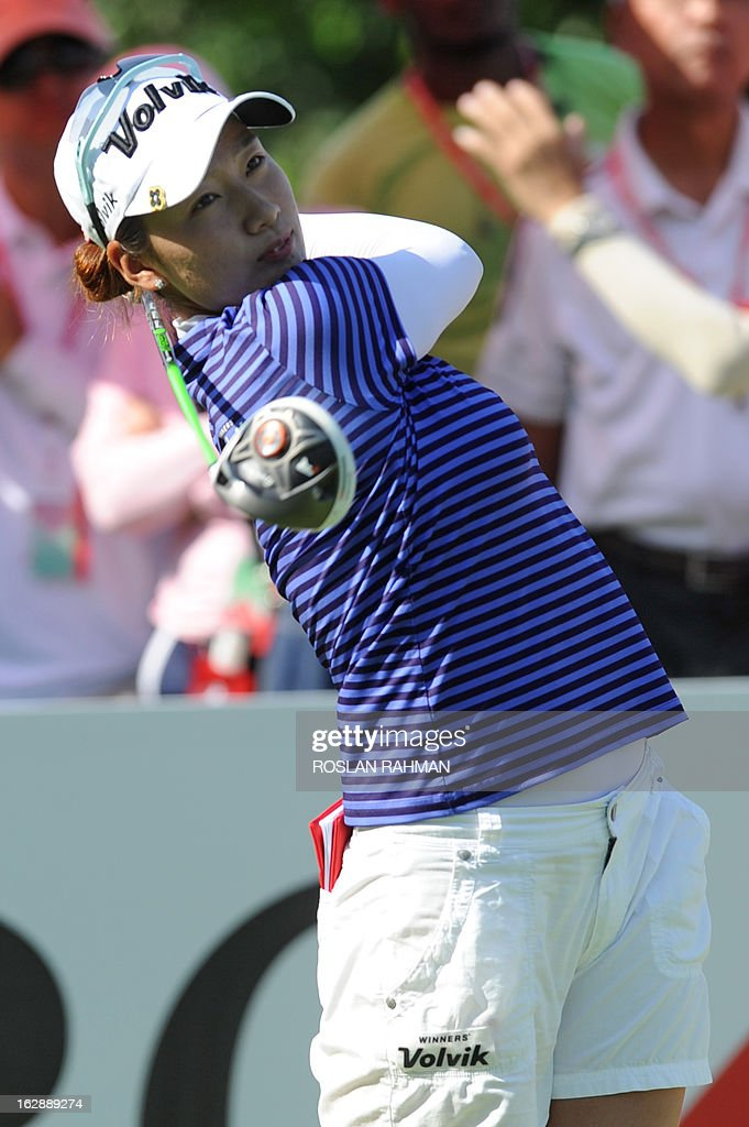 Chella Choi of South Korea hits a shot during round two of the HSBC Women's Champions LPGA golf tournament at the Serapong Course in Singapore on March 1, 2013. The 1.4 million USD tournament takes place from February 28 to March 3. AFP PHOTO / ROSLAN RAHMAN