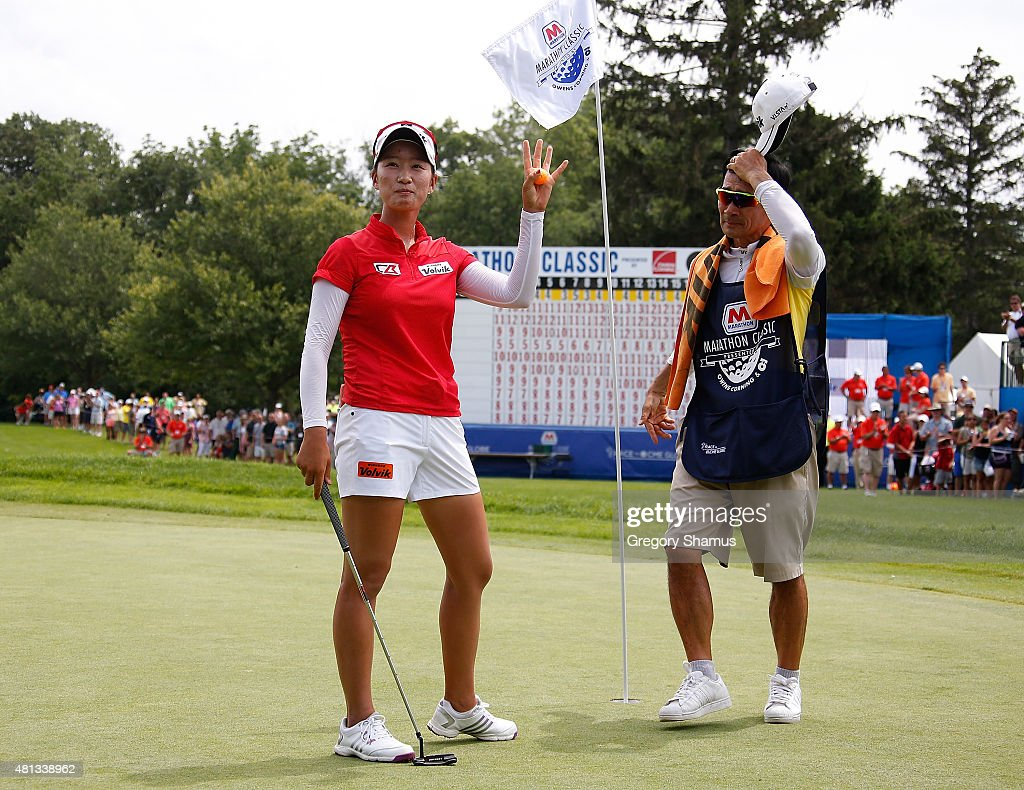 Chella Choi of South Korea next to her father and caddie waves to fans after winning the the Marathon Classic presented by Owens Corning and OI at...
