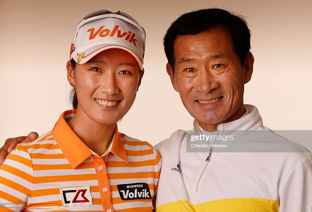 Chella Choi of South Korea poses alongside her father/caddie Ji Yeon for a portrait ahead of the LPGA Founders Cup at Wildfire Golf Club on March 17...