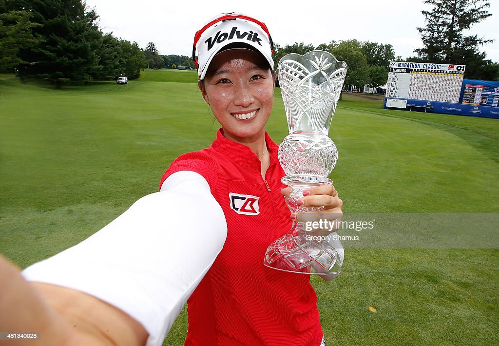 Chella Choi of South Korea poses for a simulated selfie with the trophy after winning the Marathon Classic presented by Owens Corning and OI at...