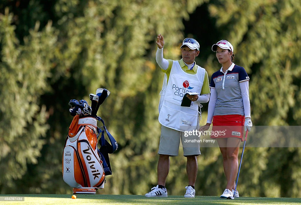 Chella Choi of South Korea talks to her caddie on the 10th hole during the first round of the LPGA Portland Classic at the Columbia Edgewater Country...