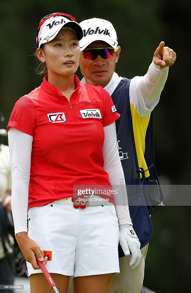 Chella Choi of South Korea talks with her father and caddie on the 18th tee during the final round of the Marathon Classic presented by Owens Corning...