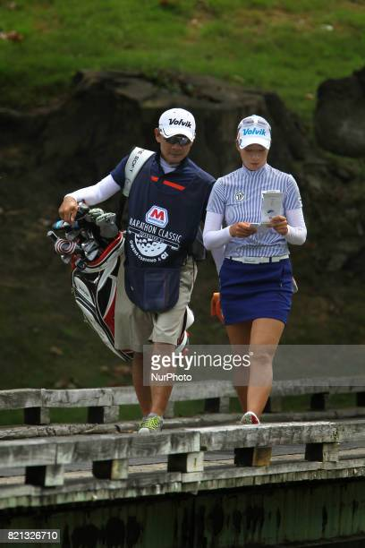 Chella Choi of the Republic of Korea crosses the bridge with her caddy on her approach to the second green during the final round of the Marathon...