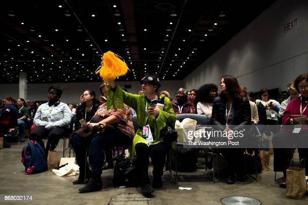 Chelle Bee center of Des Moines Iowa waves a yellow pompom in the 'Ain't I A Woman Sojourner Truth Lunch Honoring Congresswoman Maxine Waters' during...