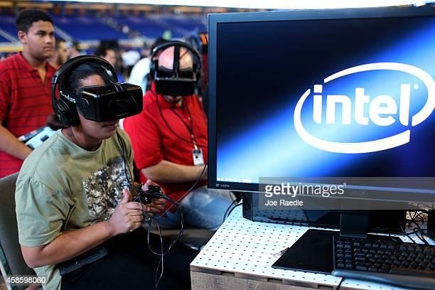 Chelleann Norris and Jeff Crile check out the Oculus virtual reality headgear on display at the Intel booth during the TigerDirect Tech Bash at the...