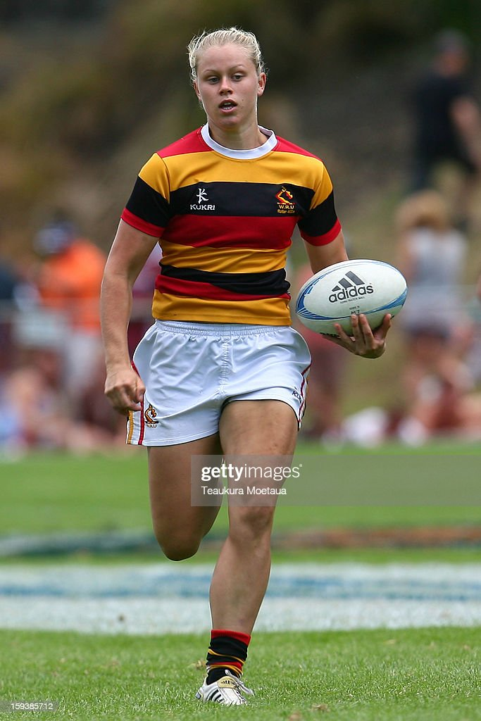 Chelsea Alley of Waikato makes a break against Taranaki during the National Rugby Sevens at the Queenstown Recreation Ground on January 13, 2013 in Queenstown, New Zealand.