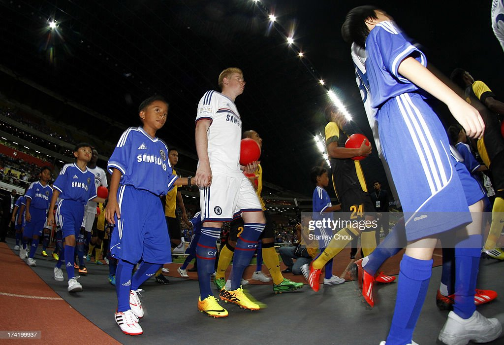 Chelsea and Malaysian team enters the field prior to the kick off during the match between Chelsea and Malaysia XI on July 21, 2013 at the Shah Alam Stadium in Shah Alam, Kuala Lumpur, Malaysia.