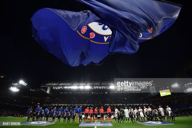 Chelsea and Qarabag players arive on the pitch ahead of the UEFA Champions League Group C football match between Chelsea and Qarabag at Stamford...