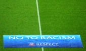Chelsea and Schalke 04 players and officials support the No to Racism action week during the UEFA Champions League Group E match between FC Schalke...