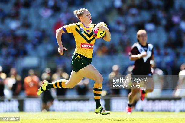Chelsea Baker of the Australian Jillaroos makes a break on her way to score a try during the 2017 Auckland Nines match between the Kiwi Ferns and the...