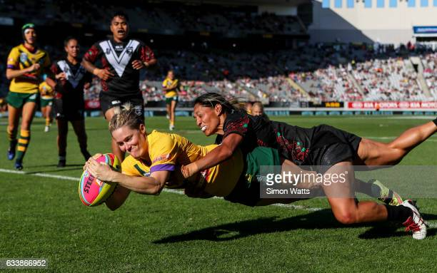 Chelsea Baker of the Jillaroos scores a try as Sarina Fiso of the Kiwi Ferns tackles during the 2017 Auckland Nines match between the Australian...