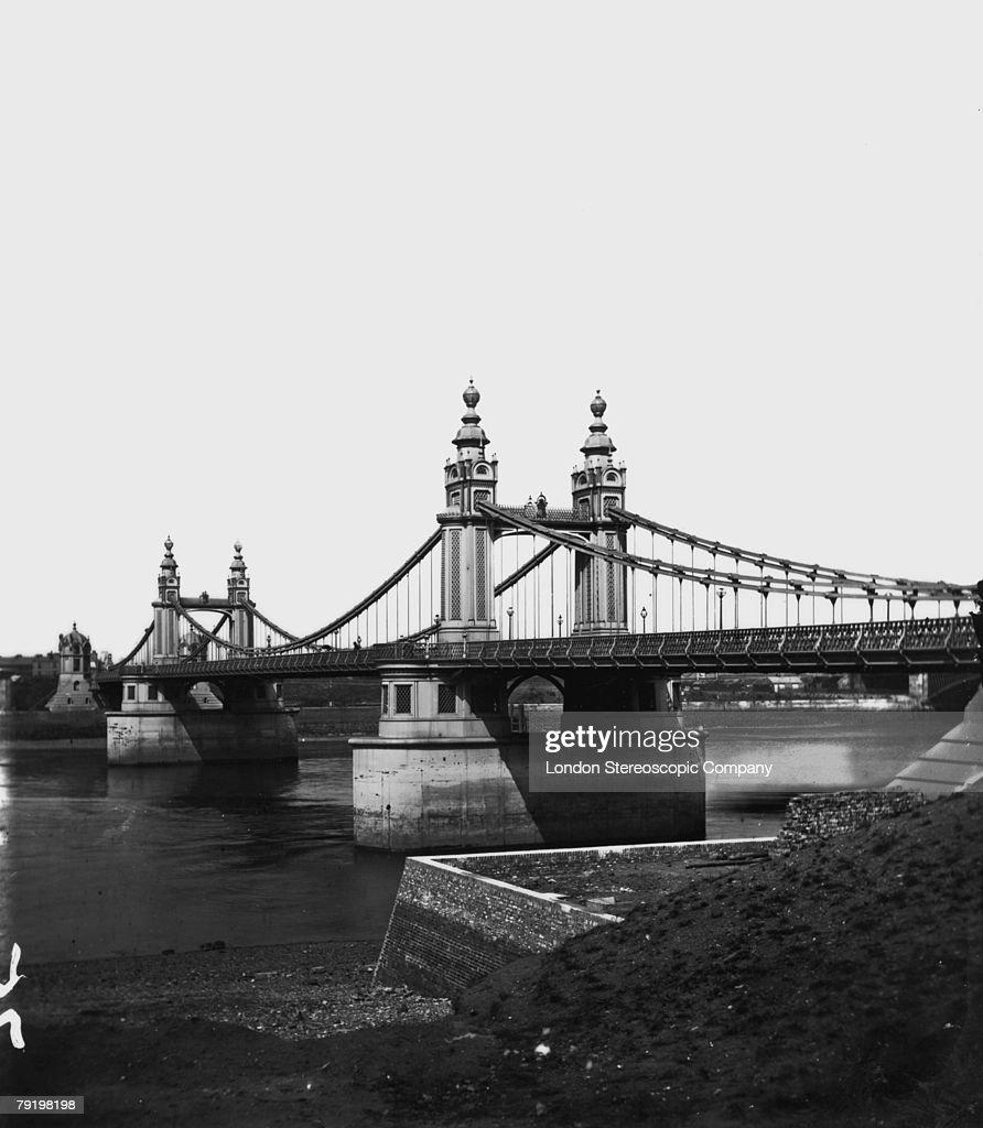 Chelsea Bridge across the River Thames in London, circa 1870.