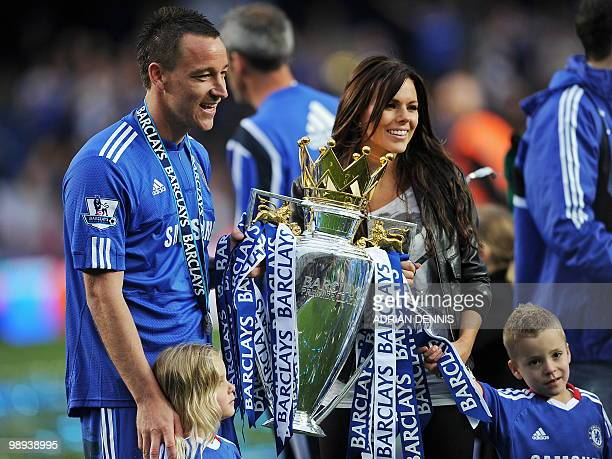Chelsea captain John Terry and his family celebrate with the Barclays Premier league trophy after Chelsea win the title with a 80 victory over Wigan...