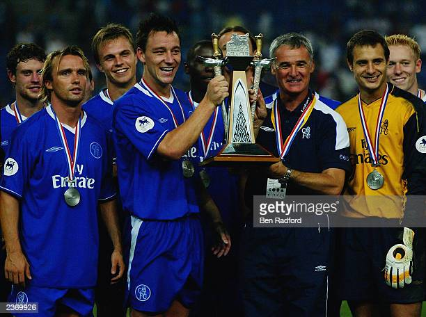 Chelsea captain John Terry and manager Claudio Ranieri celebrate victory by lifting the trophy after the FA Premier League Asia Cup Final match...