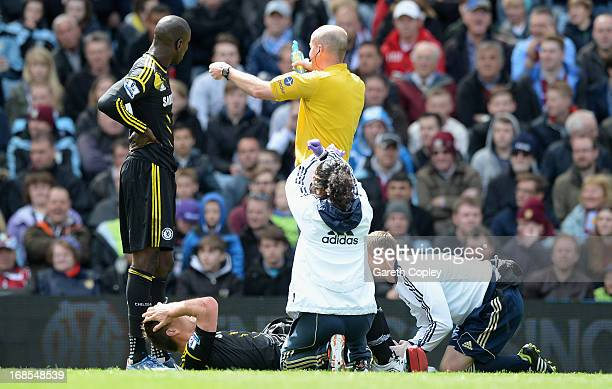 Chelsea captain John Terry has treatment after injuring his leg during Barclays Premier League match between Aston Villa and Chelsea at Villa Park on...