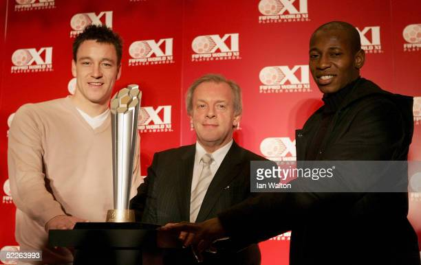 Chelsea captain John Terry PFA Chairman Gordon Taylor and Fulham player Luis Boa Morte teamed up at the unveiling of the FIFPro World XI Player...
