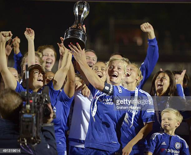 Chelsea captain Katie Chapman with the FA WSL trophy after the FA WSL match between Chelsea Ladies FC and Sunderland AFC Ladies on October 4 2015 in...