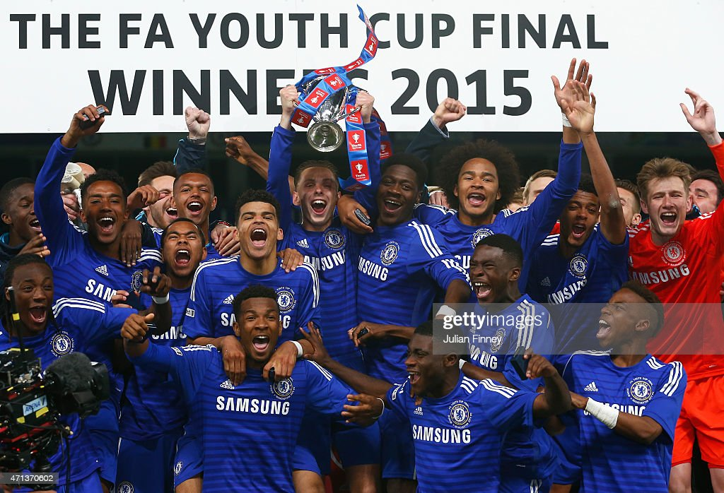 Chelsea celebrate with the winners trophy after the FA Youth Cup Final second leg match between Chelsea and Manchester City at Stamford Bridge on...