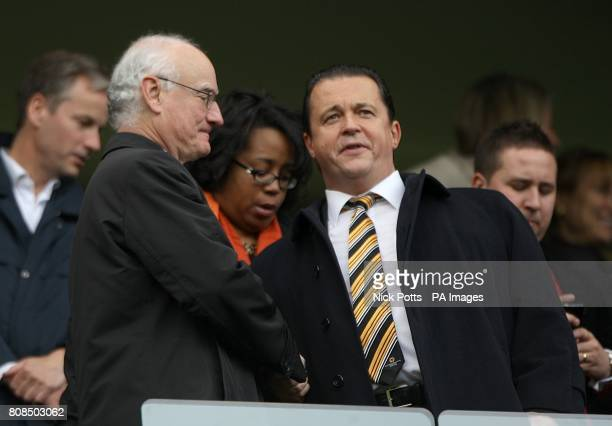 Chelsea Chairman Bruce Buck and Wolverhampton Wanderers' Chief Executive Jez Moxey shake hands in the stands