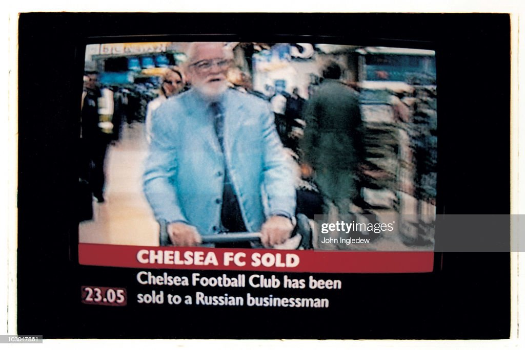 Chelsea chairman Ken Bates features on a TV news announcement that he has sold Chelsea FC to Roman Abramovich heralding a new era for the football club in June 2003 in London, England.