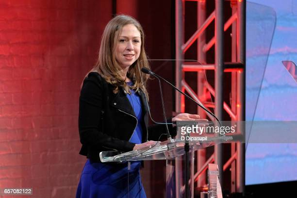 Chelsea Clinton accepts an award on behalf of her father former US president Bill Clinton during the GMHC 35th Anniversary Spring Gala at Highline...