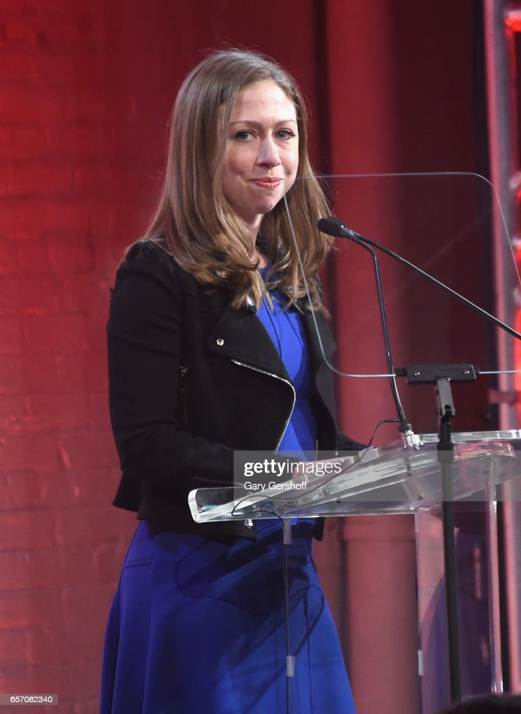 Chelsea Clinton accepts an award on stage for honoree, former US President Bill Clinton during the GMHC 35th Anniversary Spring Gala at Highline Stages on March 23, 2017 in New York City.
