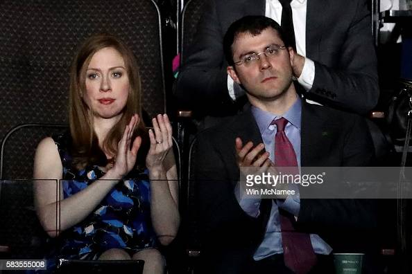 Chelsea Clinton and along with her husband Marc Mezvinsky clap as they listen to speakers on the second day of the Democratic National Convention at...