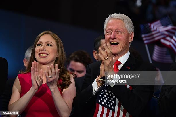 Chelsea Clinton and former US President Bill Clinton applaud as US Democratic Presidential Candidate Hillary Clinton speaks during the final day of...