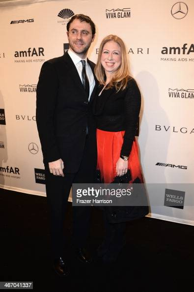Chelsea Clinton and husband Marc Mezvinsky attends the 2014 amfAR New York Gala at Cipriani Wall Street on February 5 2014 in New York City