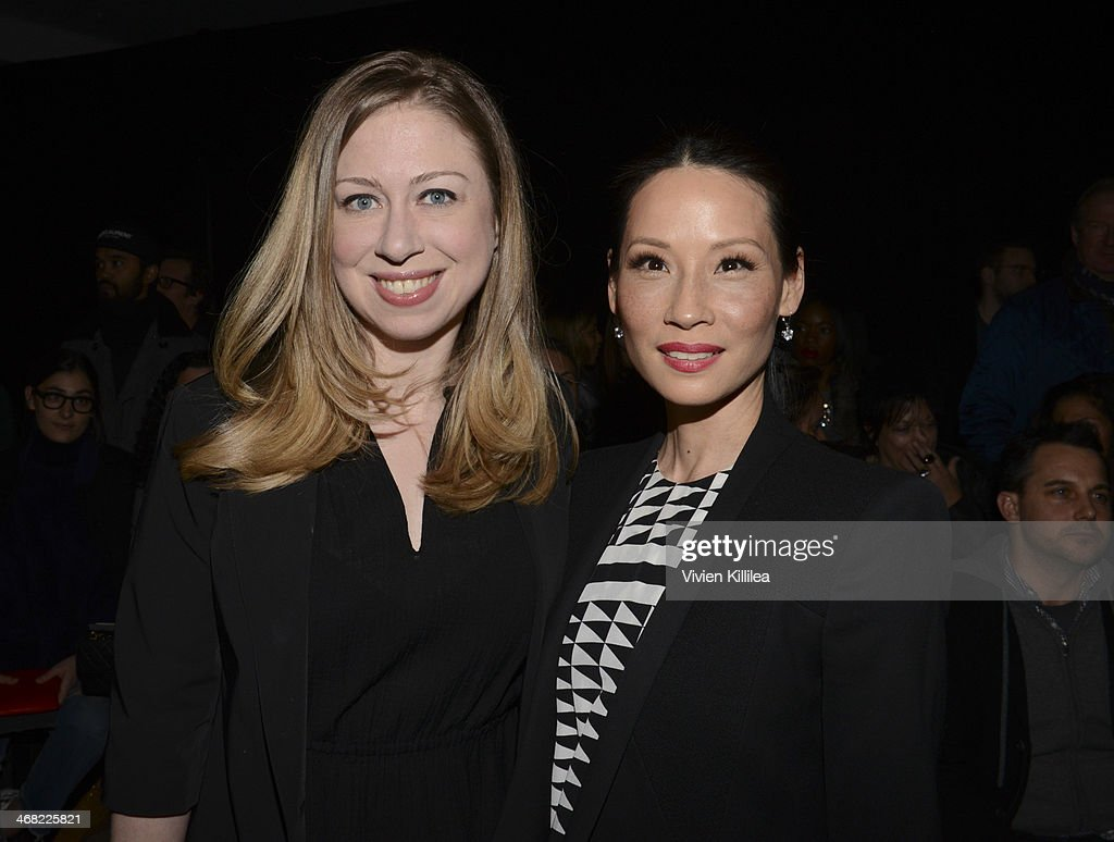 Chelsea Clinton and Lucy Liu attend the Edun show during Mercedes-Benz Fashion Week Fall 2014 at Skylight Modern on February 9, 2014 in New York City.