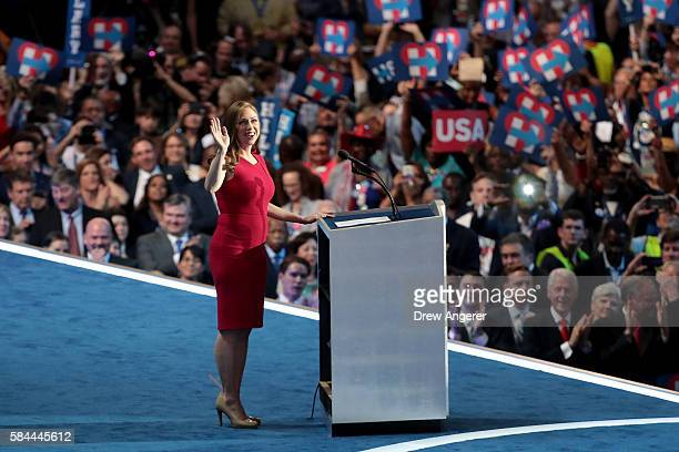 Chelsea Clinton arrives on stage to introduces her mother Democratic presidential nominee Hillary Clinton on the fourth day of the Democratic...
