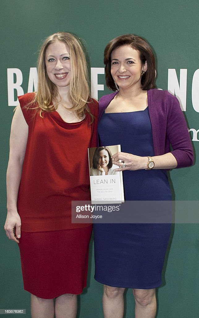 Chelsea Clinton, daughter of former U.S. President Bill Clinton and former Secretary of State Hillary Clinton, and Facebook COO Sheryl Sandberg, pose for a photograph at Barnes and Noble, March 12, 2013 in New York City. Sandberg is promoting her new book 'Lean In: Women, Work and the Will to Lead.'