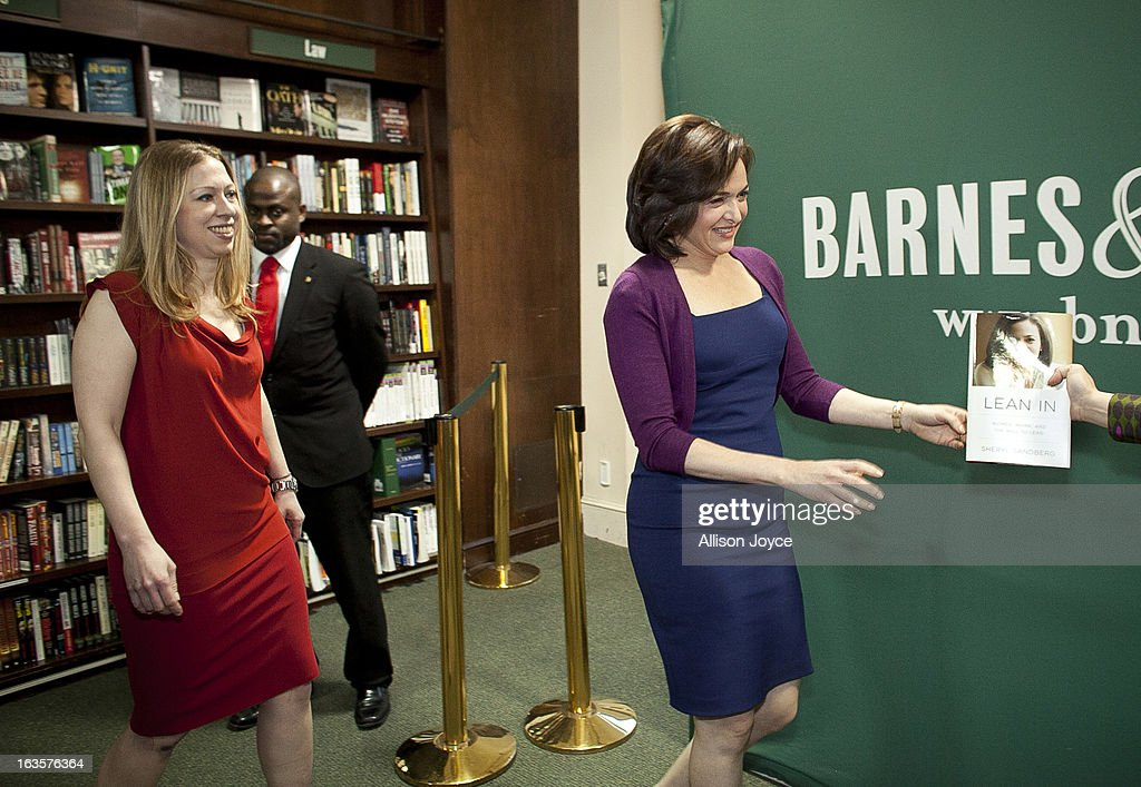 Chelsea Clinton, daughter of former U.S. President Bill Clinton and former Secretary of State Hillary Clinton, and Facebook COO Sheryl Sandberg, arrive at Barnes and Noble, March 12, 2013 in New York City. Sandberg is promoting her new book 'Lean In: Women, Work and the Will to Lead.'