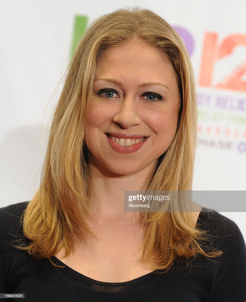 <a gi-track='captionPersonalityLinkClicked' href=/galleries/search?phrase=Chelsea+Clinton&family=editorial&specificpeople=119698 ng-click='$event.stopPropagation()'>Chelsea Clinton</a>, daughter of former U.S. President Bill Clinton, stands for a photograph at the 12.12.12 Concert for Sandy Relief in New York, U.S., on Wednesday, Dec. 12, 2012. MSG Holdings Chief Executive James Dolan and John Sykes, president of CC Media Holdings Inc., joined film producer Harvey Weinstein to help assemble top music stars to perform for free to raise money for Hurricane Sandy victims. Chase, the consumer division of JPMorgan Chase & Co., agreed to become the concert's presenting sponsor. Photographer: Peter Foley/Bloomberg via Getty Images