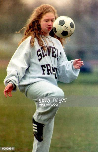Chelsea Clinton daughter of US President Bill Clinton concentrates on a ball during soccer practice 28 January 1993 in Washington DC